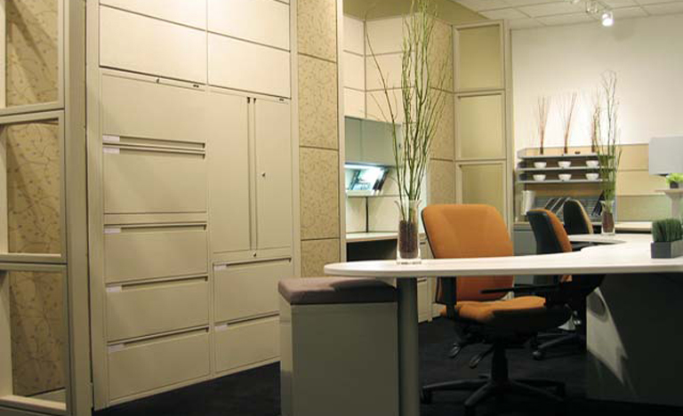 Workspace with numerous filing & storage options.